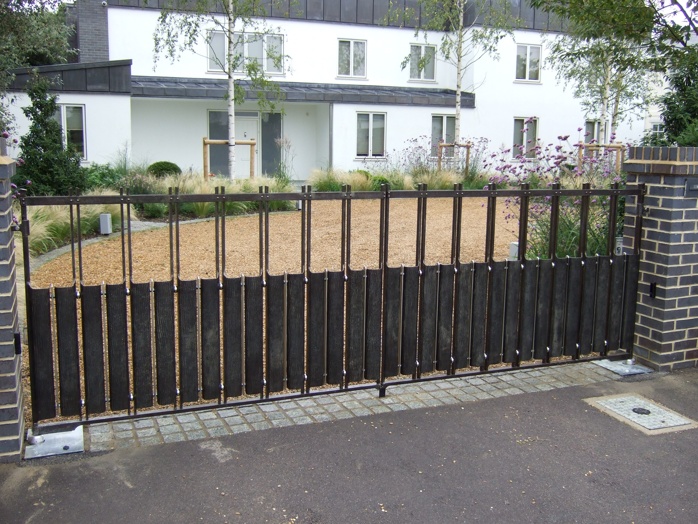 Contemprary wrought iron driveway gates by topp co for Driveway gate plans